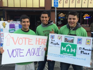 Daniel Cortes, Daniel Mendoza, and Giovanni Carreño ask market goers to vote for the permanent name of the plaza.